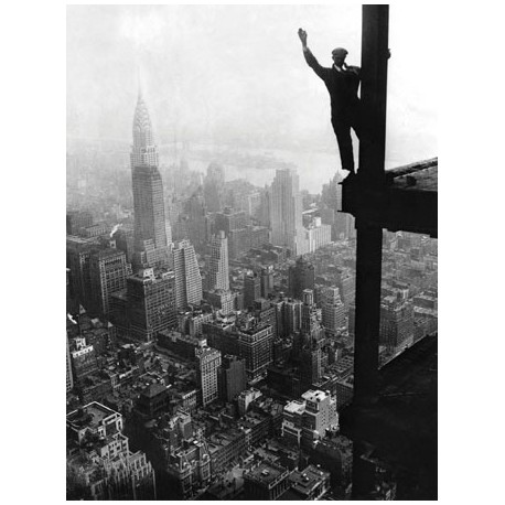 WAVING FROM EMPIRE STATE BUILDING CONSTRUCTION SITE, 1930