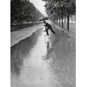 MAN CROSSING PUDDLE ON CHAIRS, 1934