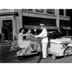 COUPLE ON MOTOR SCOOTER BUYING ICE CREAM BAR, 1954