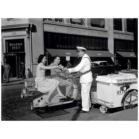 COUPLE ON MOTOR SCOOTER BUYING ICE CREAM BAR, 1954