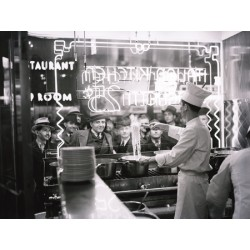 A COOK PREPARING SPAGHETTI, BROADWAY, NEW YORK CITY, 1937
