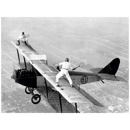 DAREDEVILS PLAYING TENNIS ON A BIPLANE, 1925