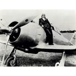 FEMALE PILOT STANDING ON AIRPLANE