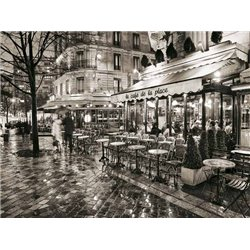 SIDEWALK CAFE ON RAINY EVENING IN PARIS