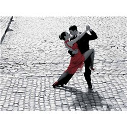 COUPLE DANCING TANGO ON COBBLESTONE ROAD