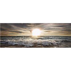 Sun shining over rocky waves